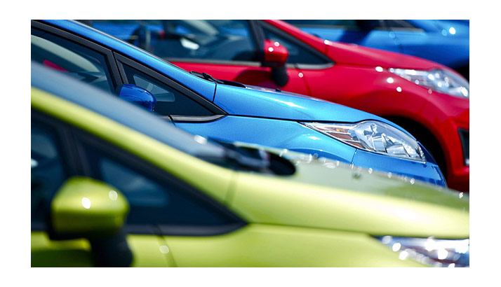 brightly-colored-cars-in-a-row
